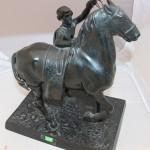Всадник, садящийся на коня. Касли