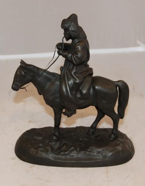 Торокинъ. Киргиз с трубкой на лошади.